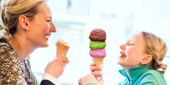 A mom and her daughter having ice cream bought with the voucherSkout credits
