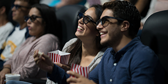 Citibank customer enjoying a movie with complimentary tickets from Emirates Citibank Ultima Credit Card