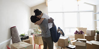 A couple hugging in joy while renovating their house with Citi Ready Credit Cash card